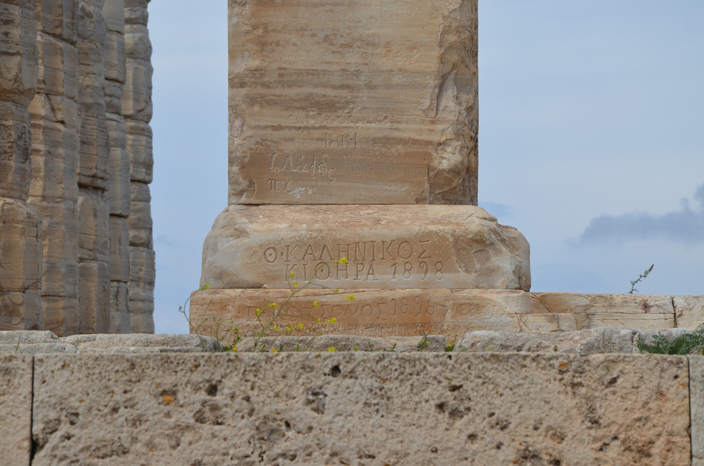 Temple of Poseidon, 19th century Graffiti on the left pillar, Cape Sounion, Greece