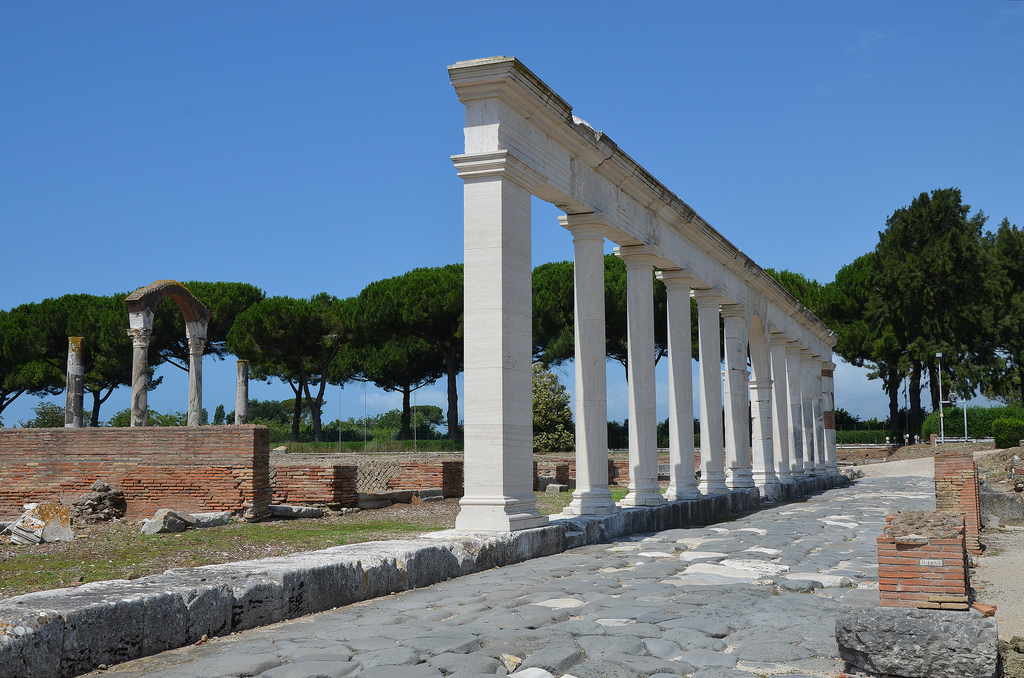 The reconstructed monumental colonnade along the Appian Way with the macellum behind, Minturnae, Minturno, Italy