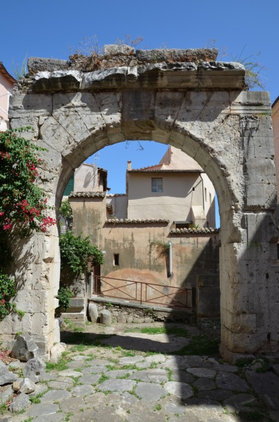 Remaining side of the quadrifrons (four-sided) arch under which lay a well-preserved stretch of the ancient Via Appia, Tarracina (Anxur), Terracina, Italy