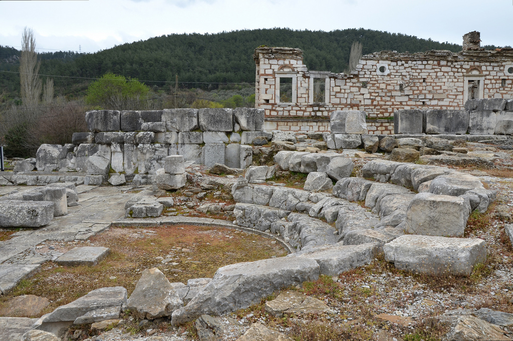 The Late Hellenistic Bouleuterion with four lower rows of seats are still preserved.