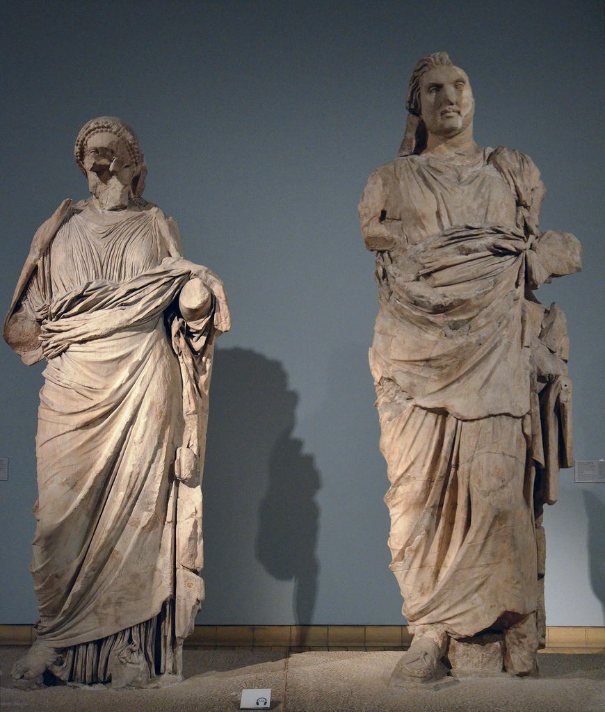 Colossal statues of a man and a woman from the Mausoleum at Halikarnassos, traditionally identified as Maussollos and Artemisia II, around 350 BC. On display in the British Museum in London.