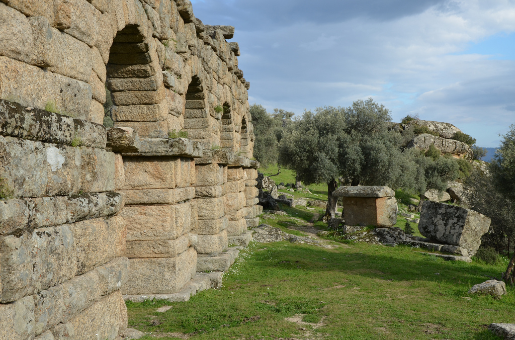 The aqueduct and sarcophagus from the late Classical necropolis.