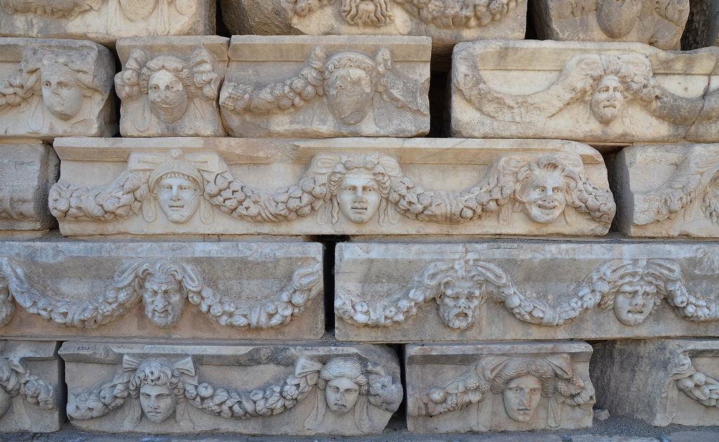 Friezes with theatre masks and portrait heads of various gods and goddesses linked by garlands, they adorned the 1st century AD Portico of Tiberius.