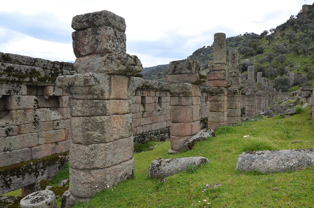Above them a long line of columns still survives dividing up what was originally a second storey; how this floor was used is unknown.