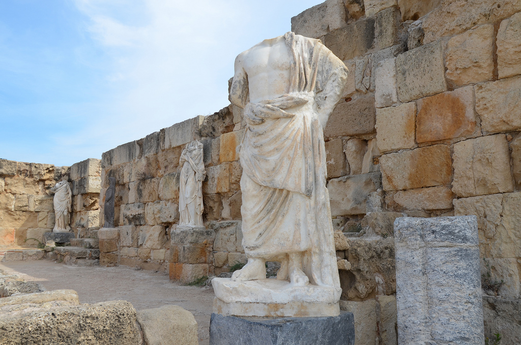 Headless statues surrounding the marble pool at NE corner of the Gymnasium's portico by dating back to the 2nd century AD (Trajanic/Hadrianic), Salamis, Northern Cyprus