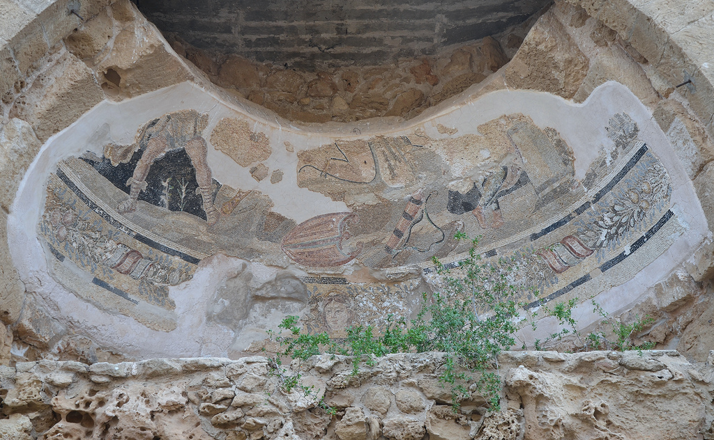 Niche in one of the room of the bath complex decorated with polychrome wall-mosaics depicting Apolllo (in the centre) and Artemis (left) slaying the Niobids, end of 3rd century AD, Salamis, Northern Cyprus