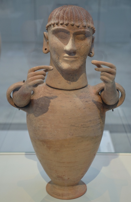 Etruscan cinerary urn with a female head and articulated arms, from Chiusi (Italy), around 550-500 BC.