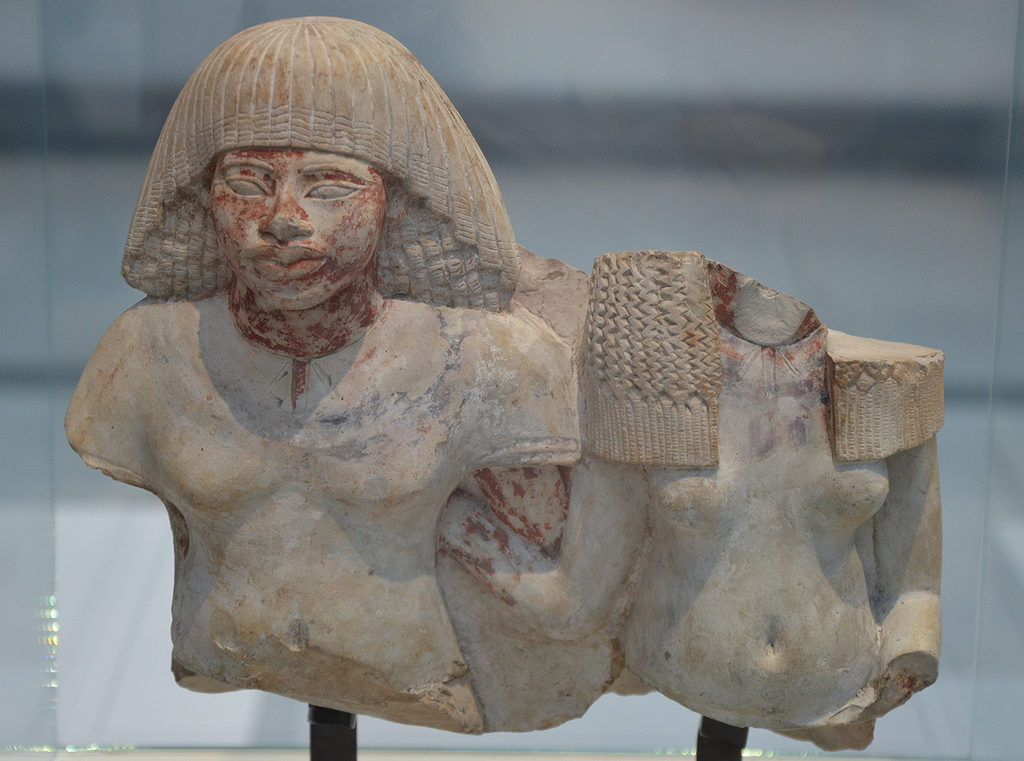 Fragment of a painted limestone statue of a deceased couple, from Egypt, around 1391-1353 BC (reign of Amenophis III).