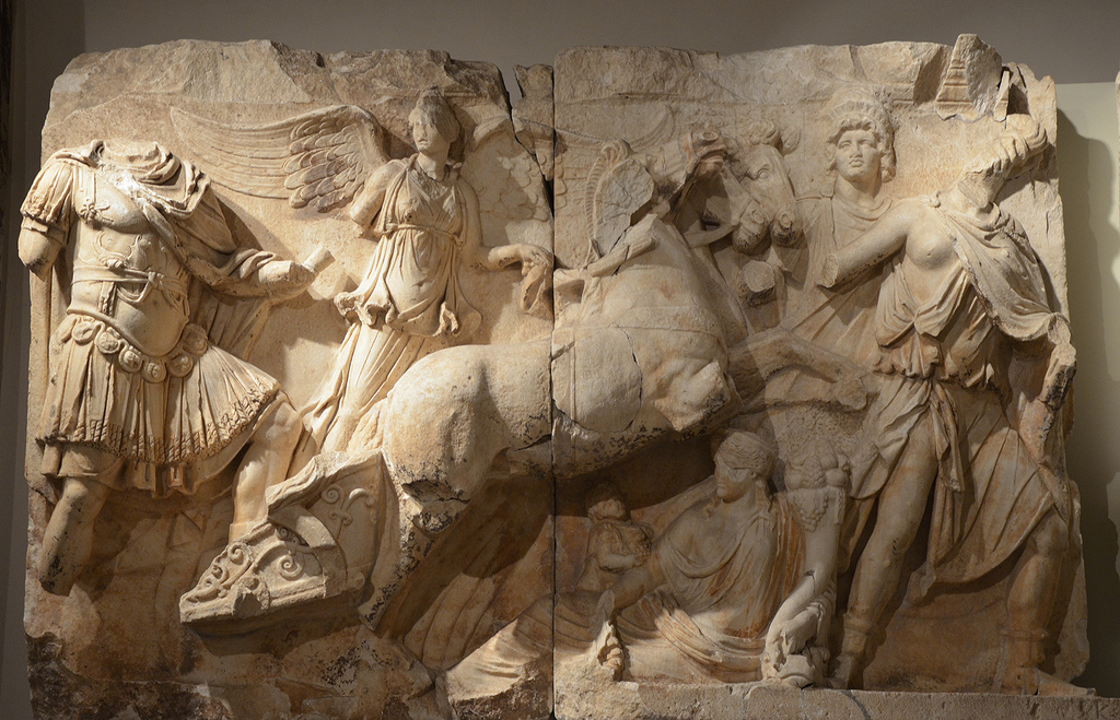 Relief frieze of the Parthian monument depicting Apotheosis of Lucius Verus, Lucius Verus is represented on Helios' chariot being driven by Nike (Victory) who leads him by the hand.