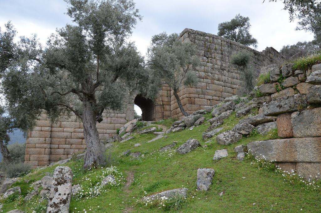 The retaining wall of the cavea of the Hellenistic Theatre with the arched entrance leading to the diazoma.