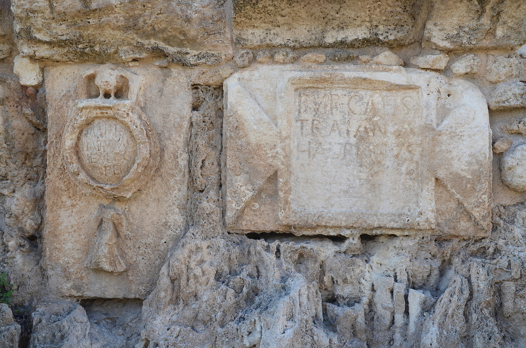 Dedicatory inscription to Hadrian on the high-level aqueduct of Caesarea at Beit Hanania with the emblem depicting the 10th legion.