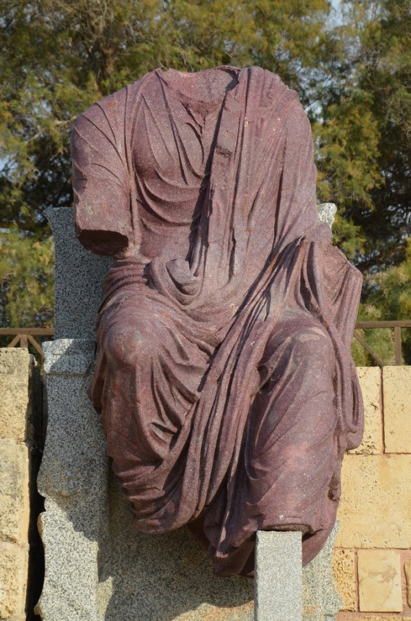 Porphyry statue of Hadrian seated and holding scepter and orb (now missing).