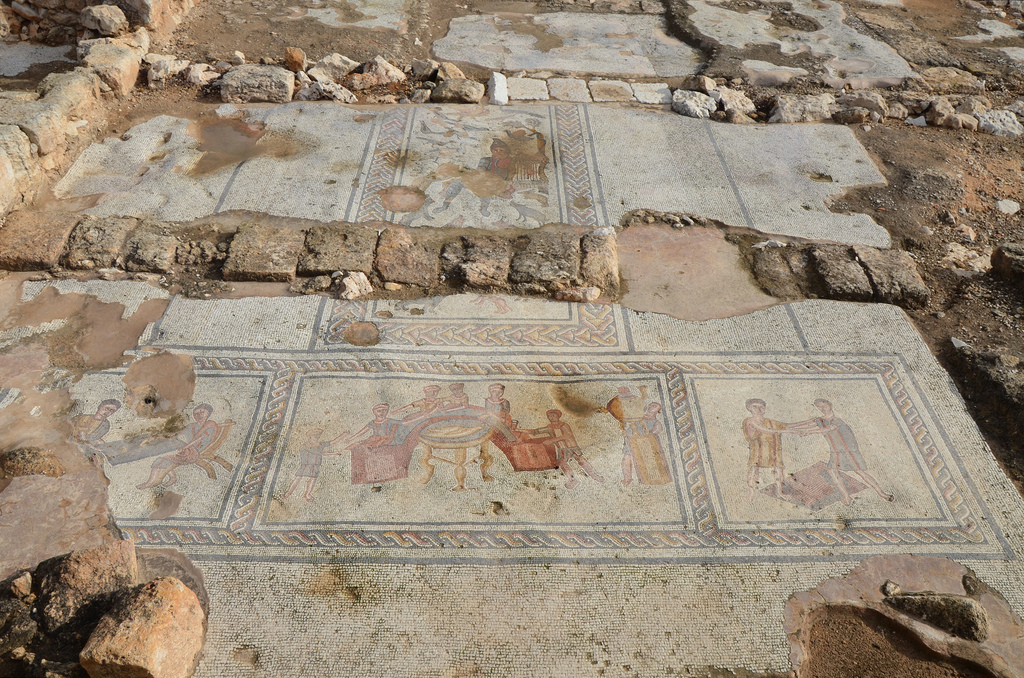 T-shaped mosaic in the triclinium of The House of Orpheus containing four panels arranged for viewing from the south.