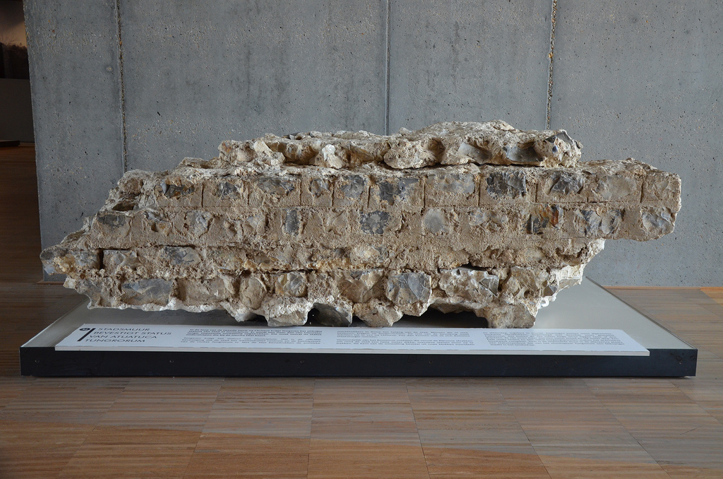 Fragment of the city walls consisting of rough blocks of flint and rubble set in mortar, the city walls were built in the 2nd centuy AD and were more than 4km in length. Gallo-Roman Museum of Tongeren, Belgium.