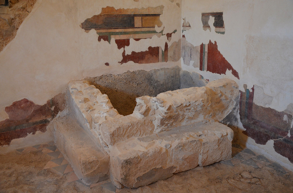 North-east corner of the apodyterium (undressing room), the lower parts of the original frescoes have been covered by a tiny bathing pool added either by the Zealots or the Roman garrison.