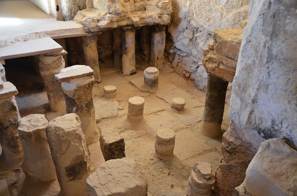 A section of the hot room (caldarium) in Herod's large bathhouse with a double floor suspended over small stones and clay pillars.