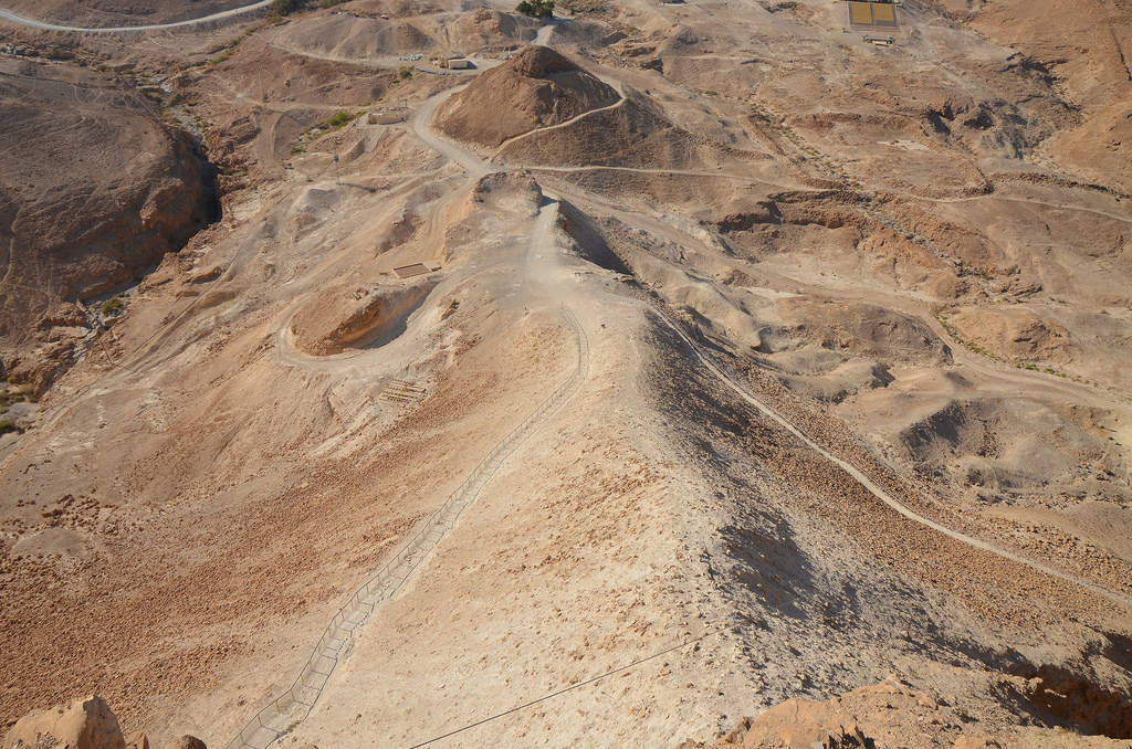 View from the hilltop of Masada of the Roman siege ramp and remnants of Camp E, one of several legionary camps.