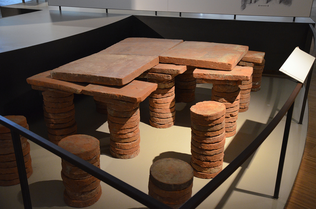 Underfloor heating (hypocaust) from a luxury residence, the floor was supported by pillars of round terracotta blocks. Gallo-Roman Museum of Tongeren, Belgium.