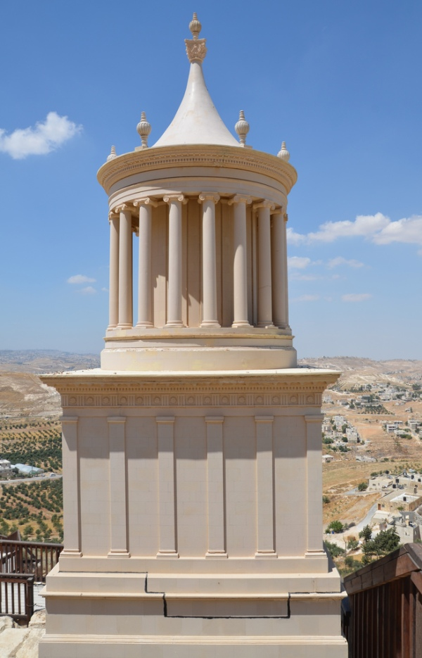The model of Herod's mausoleum, the first storey was a plinth which supported the second, square one; above this was a circular tholos, which incorporated an internal chamber surrounded by an Ionic colonnade, topped by a dome.