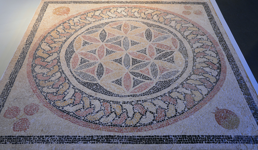 Mosaic floor from Herod's Palace at Herodium with a rosette at its centre and palmettes and pomegranates in the corners. Israel Museum, Jerusalem.