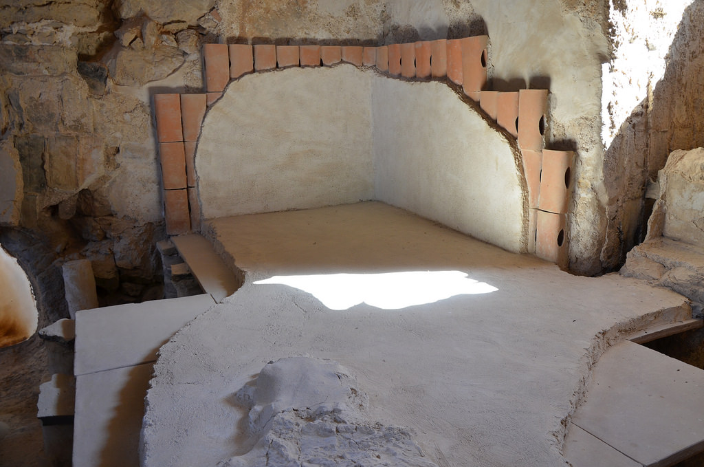 A section of the hot room (caldarium) in Herod's large bathhouse with clay pipes along the walls that were used to allow the hot air to warm up the side of the pool.