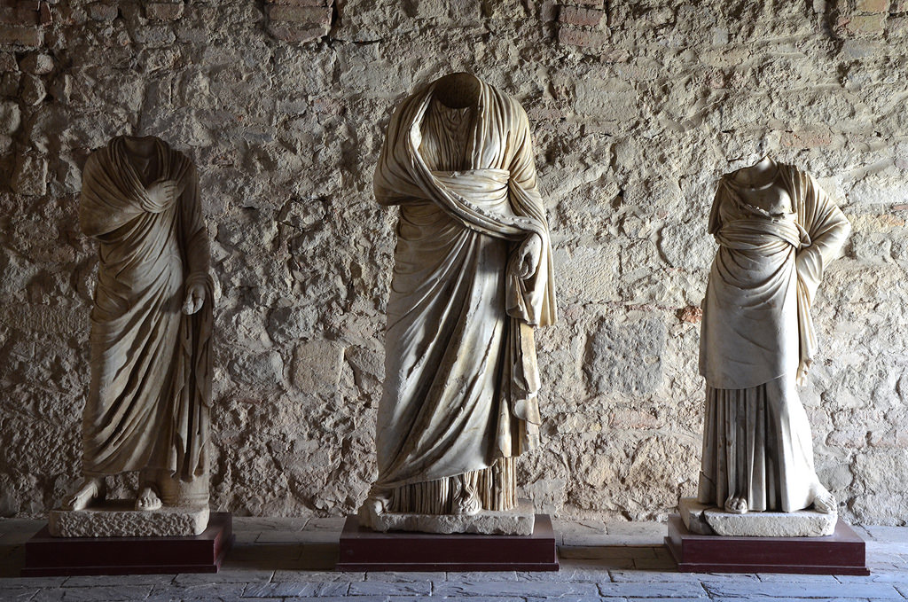 Roman statues exhibited inside the refectory of the 14th century Ardenica Orthodox Monastery.