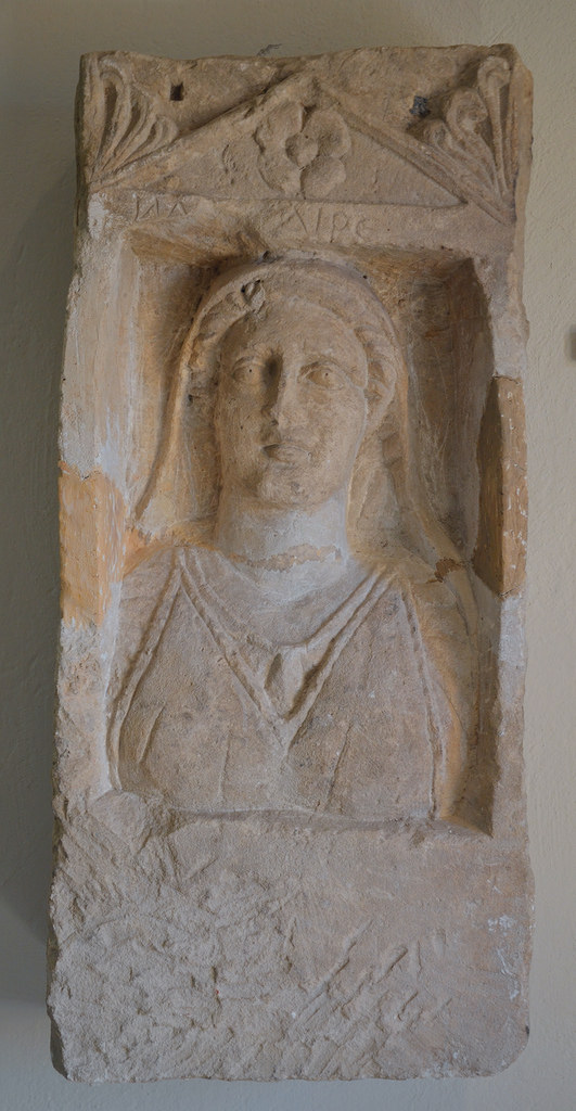 Funerary stele depicting a woman with Illyrian clothes, 2nd century BC.