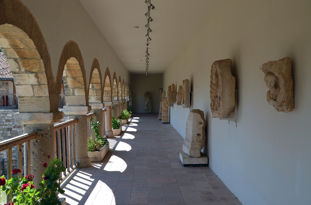 Balcony of the North wing of the museum with reliefs and statues taken from the nearby Greek Illyrian site of Apollonia, Ardenica Monastery, an Eastern Orthodox monastery near Apollonia.