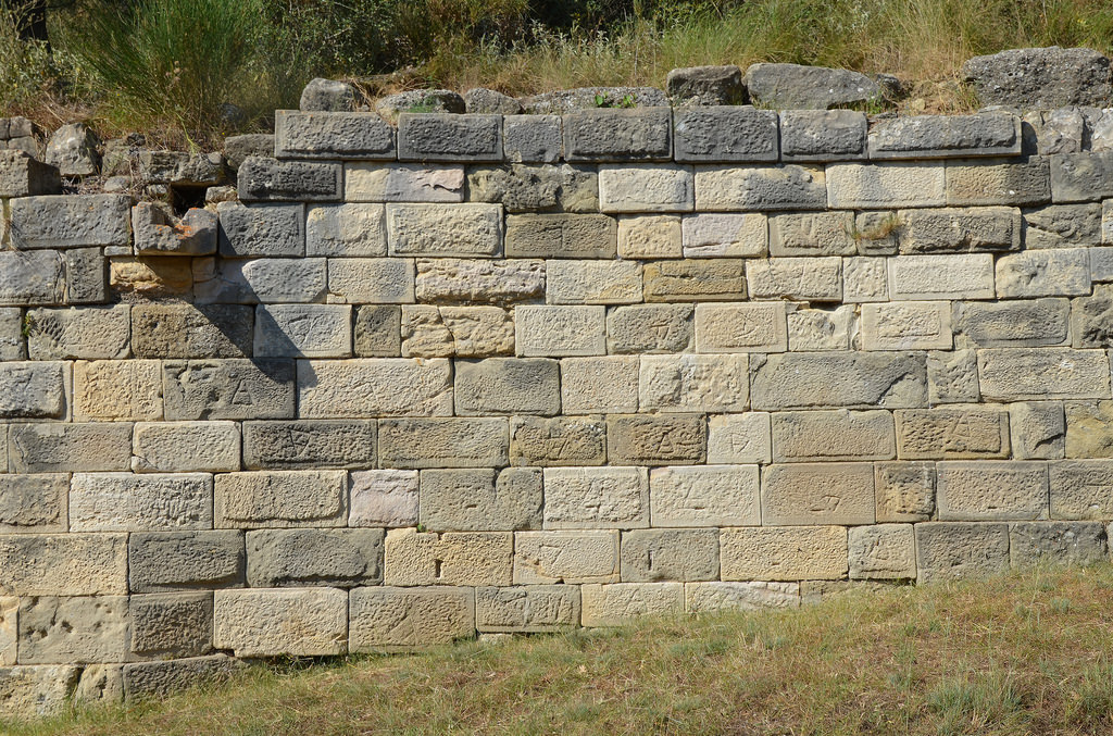 The southern wall of the Temenos, an ornamental wall bordering the sacred temenos area of the Temple of Apollo dating to the 3rd century BC.