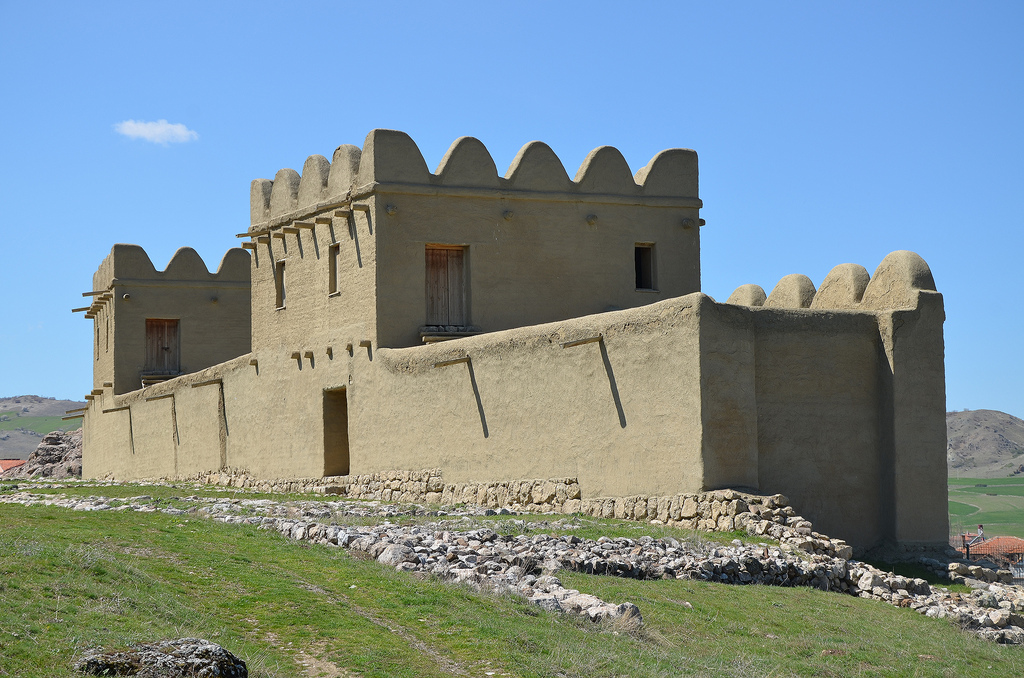 Modern reconstruction of a 65m long section of the city wall made of mud brick.