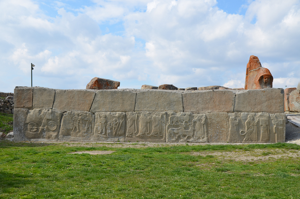 The external facade of the west tower located in front of the Sphinx Gate ornamented with relief-decorated orthostats (original reliefs in Museum of Anatolian Civilizations).