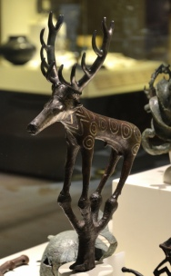 Deer bronze statuette with silver inlay used in rituals.