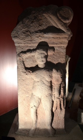 Stela depicting Hercules fighting.