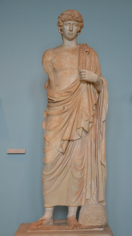 Statue of the deified Antinous represented as Asklepios, found in the outer court of the sanctuary which it apparently adorned, 2nd century AD (Archaeological Museum of Eleusis).