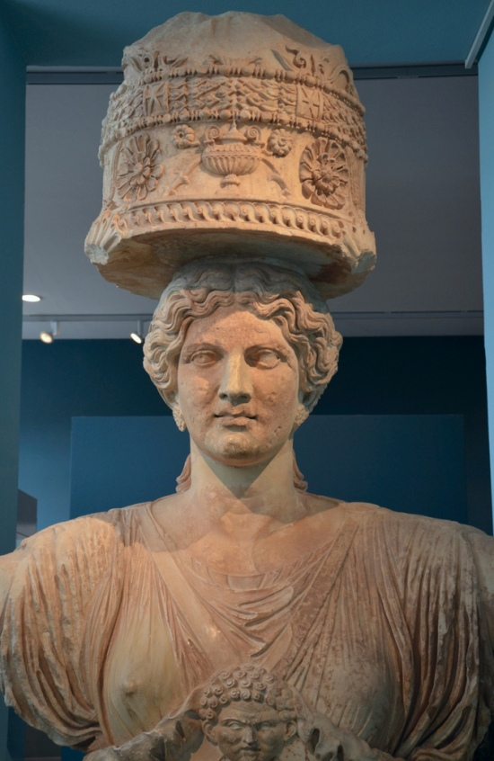 The upper part of one of the caryatids that flanked the Lesser Propylaea of Eleusis, made in Attica in about 50 BC (Eleusis Museum).