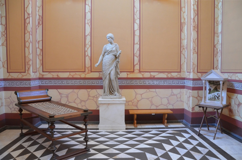 The reconstructed lararium, the sacred place of the house, and a statue of Clio, the muse of history and and a reconstructed lararium, a shrine to the guardian spirits of the Roman household (Lar Familiaris).