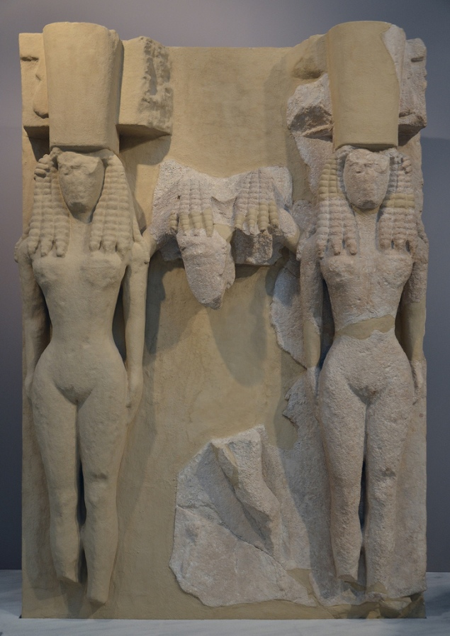 Large relief plaque of poros stone depicting naked Goddesses wearing the polos crown, from the Archaic Temple of Athena in Gortyn, mid-7th century BC.