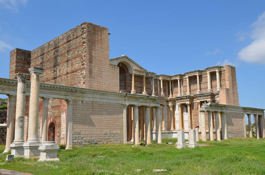 "The first story carries Ionic capitals, the second a type k n o w n as ""acanthus-and-fluting."""