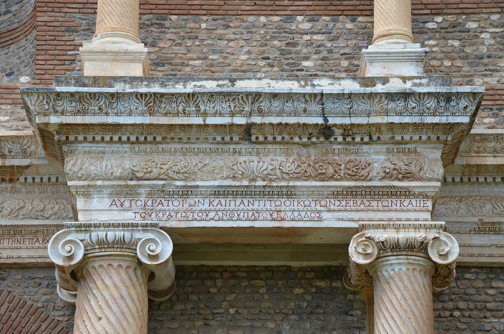 The inscription on the first story (with red-painted letters) dedicates this space to the Roman Imperial family: Emperors Caracalla and Geta, and their mother Julia Domna; and records that the hall was gilded by the city and two ladies of consular rank.