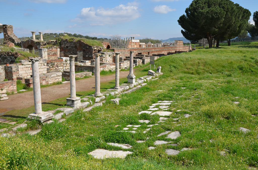 A short segment of the Roman main street paved with marble blocks and flanked by covered porticoes.