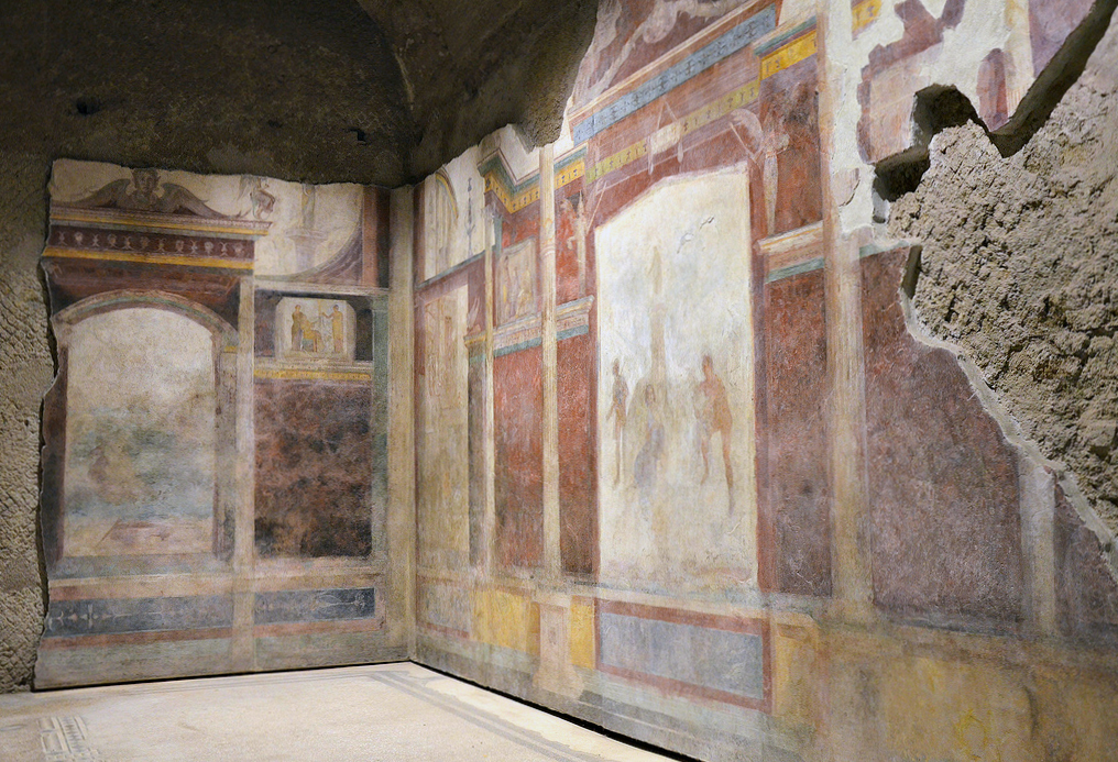 The tablinum with the mythological scenes in the center of both walls. The mythological scene on the right-hand wall of the tablinum is still partly visible.