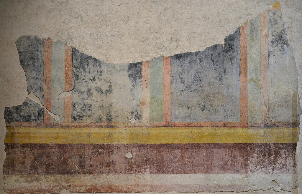 Wall painting fragment alternating wide black and narrow green panels framed in red and bordered above and below in yellow bands.