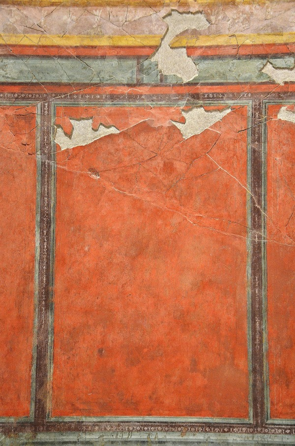 """North wall of the """"Large oecus"""" with wall painting imitating marble wall-facing."""