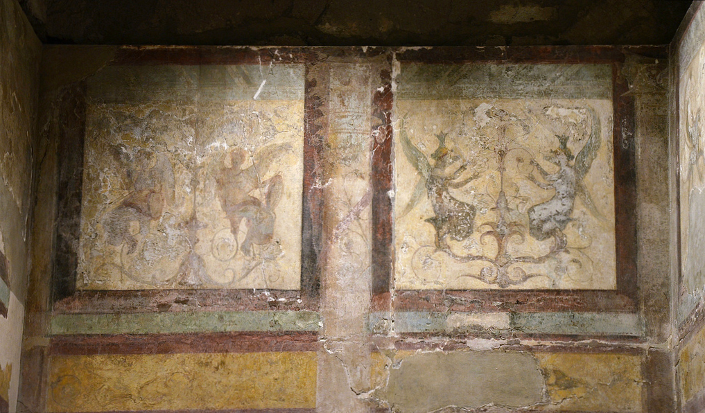 Fresco detail in the upper zone of the left-hand room with winged females figures, perhaps Victories.